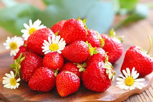 Ripe fresh strawberries on wooden table