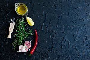 Rosemary, garlic, lemon, chili pepper and olive oil