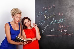 Female students at the blackboard