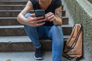 tattooed girl with a smart phone