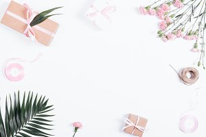 ribbons and flowers on white table