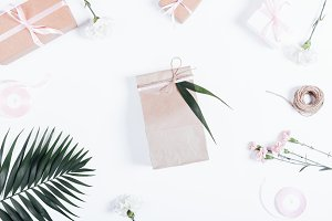 bag with a gift and flowers