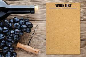 Bottle of wine and blank wine list