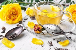 Herbal tea with yellow rose