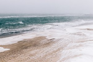 beach and sea during blizzard