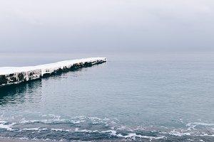 Snowy and frozen pier