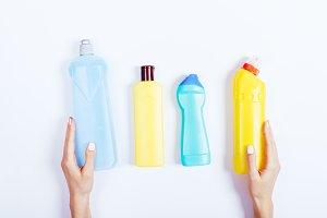 Female hand holding bottles