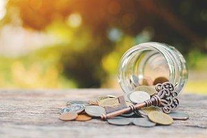 coin in glass jar