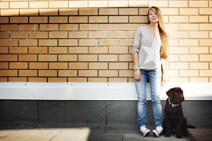 Young woman with her dog labrador