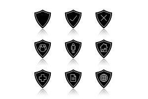 Protection shields drop shadow black glyph icons set