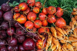 Fresh red beets and carrots close up