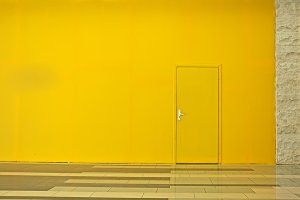 Yellow wall with a door