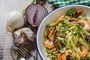 Green tagliatelle with seafood.