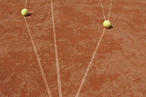 Business metaphor with tennis balls