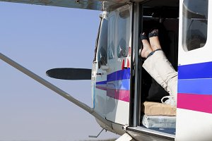 Female legs in a helicopter
