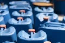 Old blue canisters for oil products