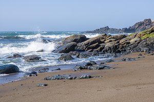 Surf and waves on a rocky coast