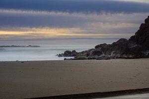 Foggy mist over the surf on a rocky coast