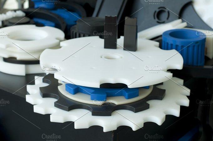 Plastic machine parts. Vertical imag - Industrial