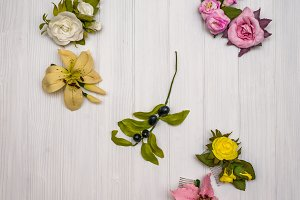 Artificial flowers on a wooden board