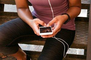 Sportswoman texting message