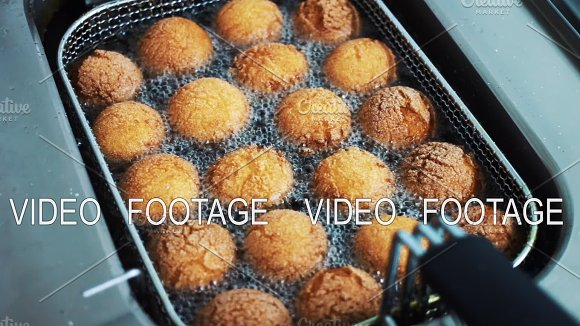 Preparation Of Donuts In Hot Oil In The Deep Fryer Boiling Oil With Donuts Close-up The Cook Is Preparing Food