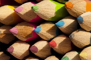 Multicolored pencils arranged backgr