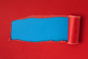 Red torn paper with blue space for t
