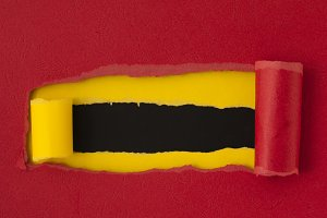 Red torn paper with yellow space for