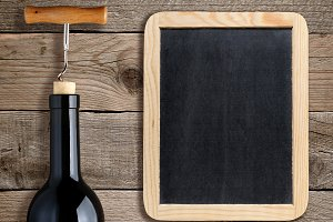 Bottle of wine and blank blackboard