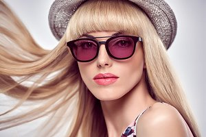 Fashion Portrait Blond Girl in Stylish Sunglasses