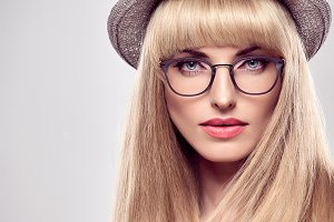 Fashion Portrait Blond Model in Stylish glasses.