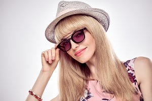 Fashion Portrait Blond Model in Stylish Sunglasses