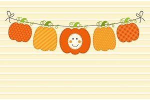 Cute autumn garland with pumpkins in traditional colors