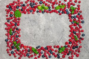Berries frame on concrete background