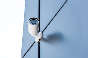security camera on blue wall