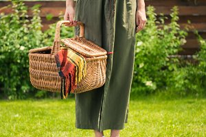 woman holding picnic basket