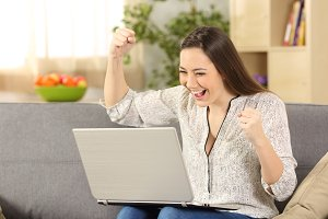 excited woman checking news