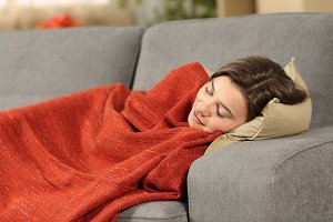 Girl sleeping covered with blanket
