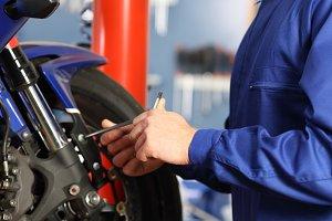 Motorbike mechanic hands