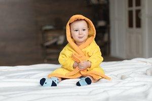 baby boy in yellow robe