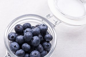 Close-up of glass bowl with blueberries.