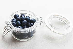 Top view of glass bowl with blueberries.