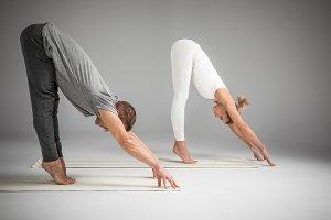 sportive couple practicing yoga