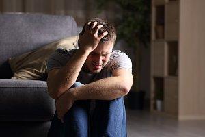 Sad man lamenting