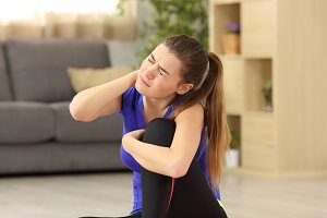 Sportswoman suffering neck ache
