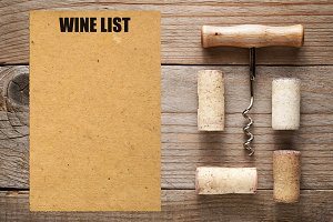 Wine list and corks with corkscrew