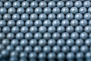 blurred background of grey airsoft balls of 6mm
