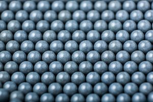 background of gray airsoft balls of 6mm