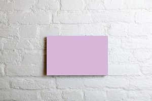 Pink blank poster in a white brick wall. Template Mock up for your content